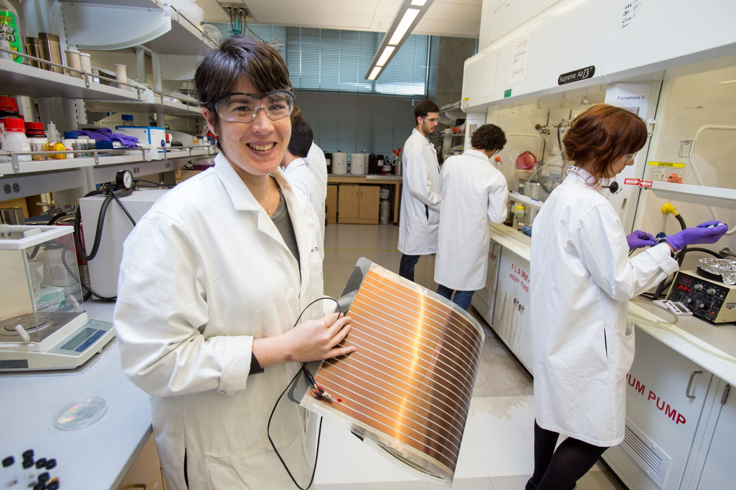Woman holds thin energy material